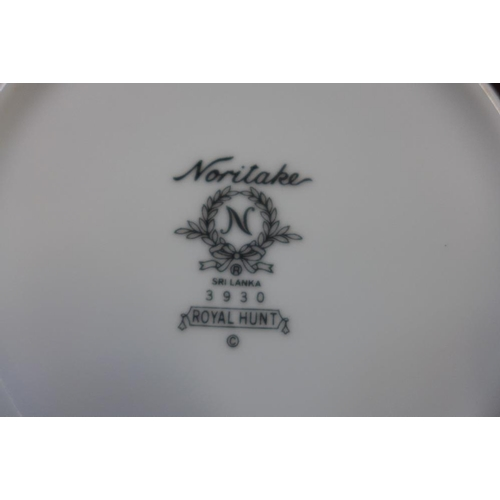 19 - A Noritake Royal Hunt dinners service, twelve setting , some usage marks, but generally good...