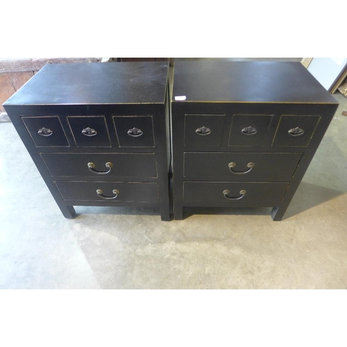 29 - A pair of black five drawer bedside chests, 60cm tall x 50cm x 34cm...