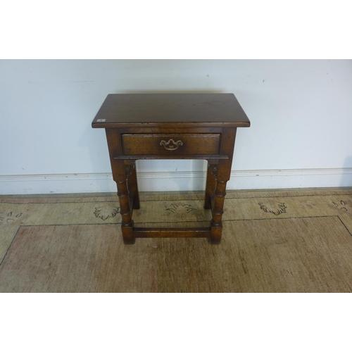 5 - A modern oak antique style single drawer side table - 72cm tall x 61cm x 35cm...