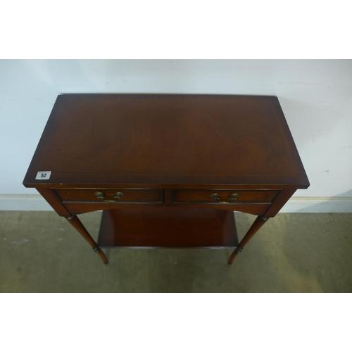 52 - A small mahogany two drawer hall table - 76cm tall x 66cm x 32cm...