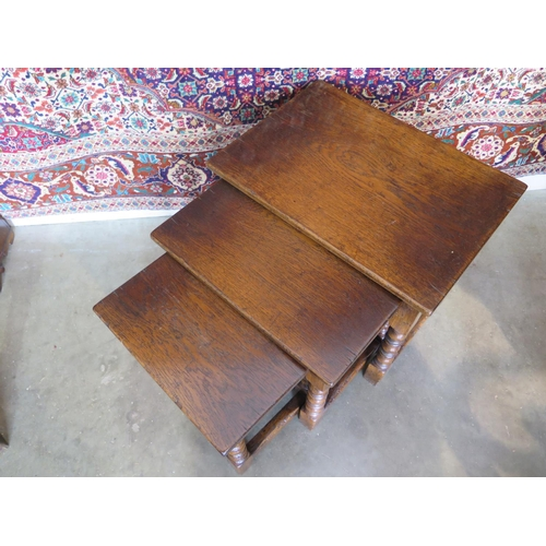 6 - A nest of three oak antique style side tables - 47cm tall x 56cm x 40cm...