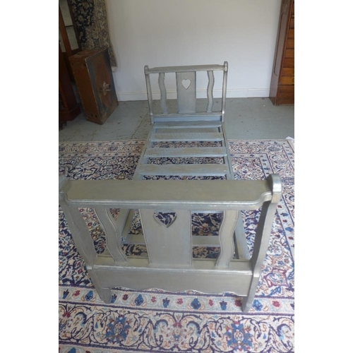 22 - A silver painted day bed with heart motif 76cm tall x 167cm x 68cm...
