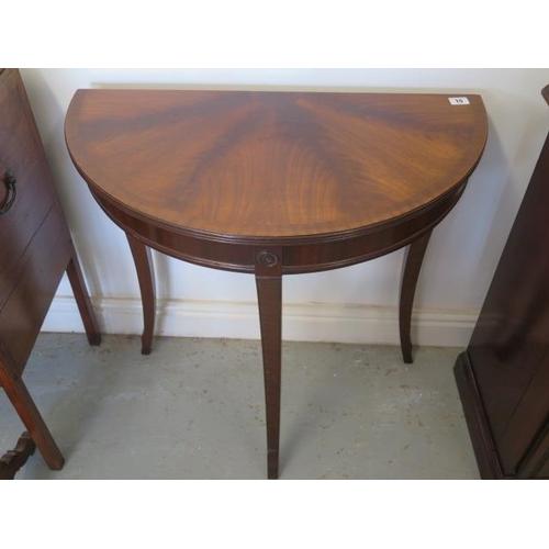 35 - A Regency style Demi Lune mahogany side table...
