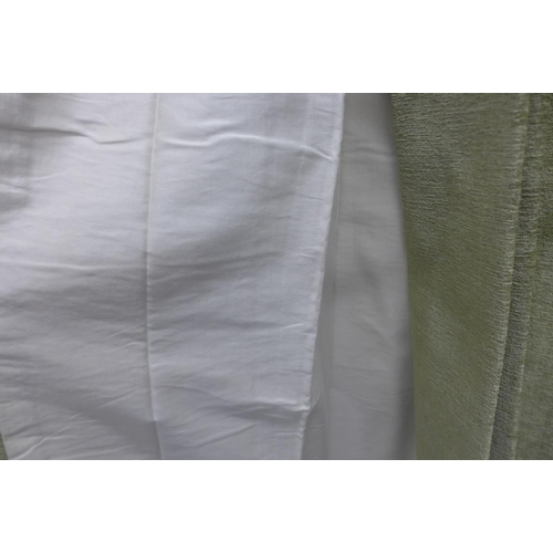37 - A pair of moss green lined and dry cleaned 46 inch wide x 96inch drop curtains...