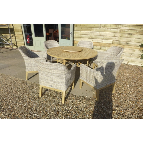 24 - A Bramblecrest aluminium circular table with rattan armchairs, ex-display...