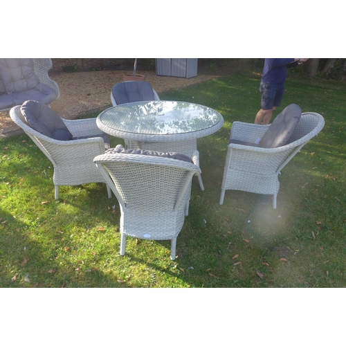 52 - A Bramblecrest 120cm round table with four chairs, ex-display...