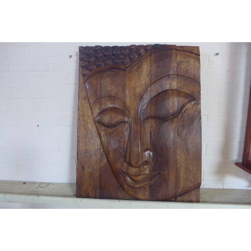 11 - A carved Buddha wooden panel, 77 x 59cm...