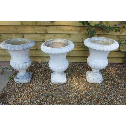 12 - Three stone effect painted garden urns, 68cm tall, 46cm diameter...