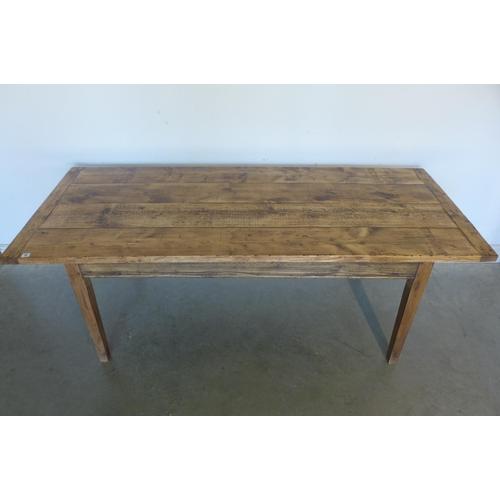 20 - A rustic pine kitchen table, 74cm H x 204cm x 86cm...