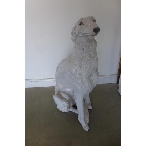 3 - A ceramic figure of a seated Lurcher, 100cm high...