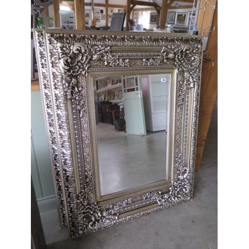 44 - A modern ornate mirror measuring 94x123cm - can be hung either way...