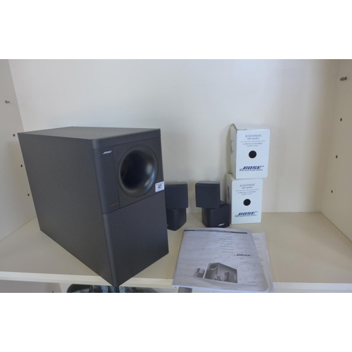47 - A pair of Bose Acoustimass 5 series cube speakers, and a Bose  subwoofer, with instructions, no cabl...