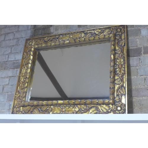 38 - An ornate carved gilt mirror 79x101cm...
