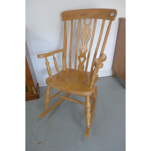 39 - A modern Victorian style beech rocking chair, in good polished condition...