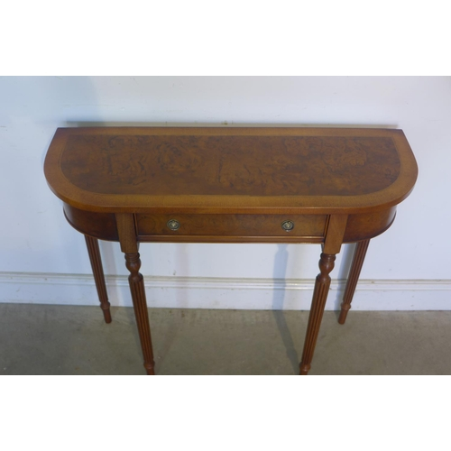 40 - A walnut D shaped hall table with a single drawer on turned legs, made by a local craftsman to a hig...