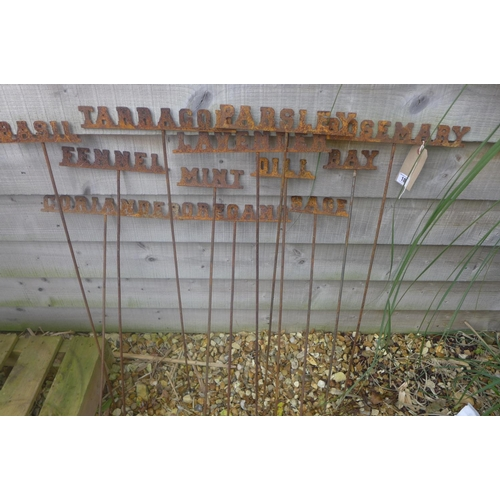 18 - A set of twelve wrought iron garden herb name markers, 88cm H...