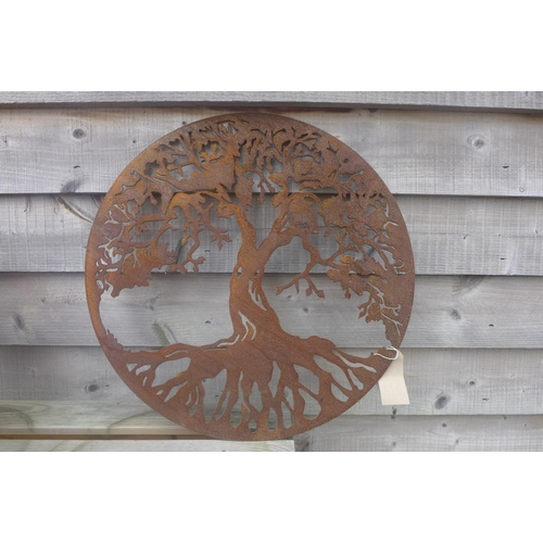19 - A pierced steel decorative circular wall panel depicting the Tree of Life - 58.5cm diameter...
