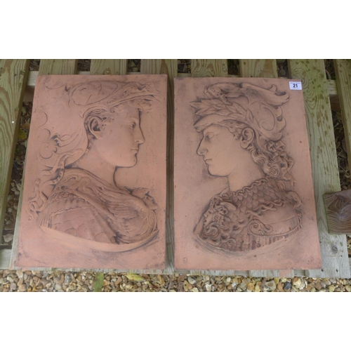 21 - A pair of Renaissance style terracotta garden wall plaques depicting two helmeted gods - 46cm H x 29...