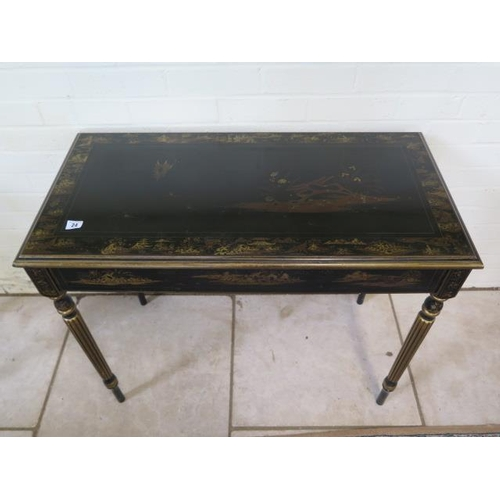 24 - A chinoiserie decorated side table on turned reeded legs, 76cm tall x 90cm x 45cm...