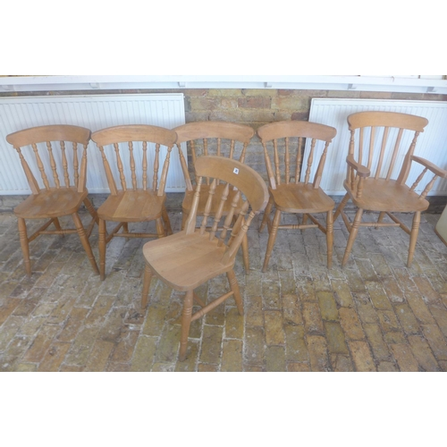 25 - A set of six beech wood dining kitchen chairs, including a carver...