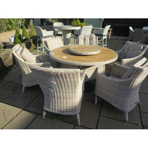 29 - A Bramblecrest Ascot dining set, table 140cm with ceramic top, lazy Susan and six armchairs, ex-disp...