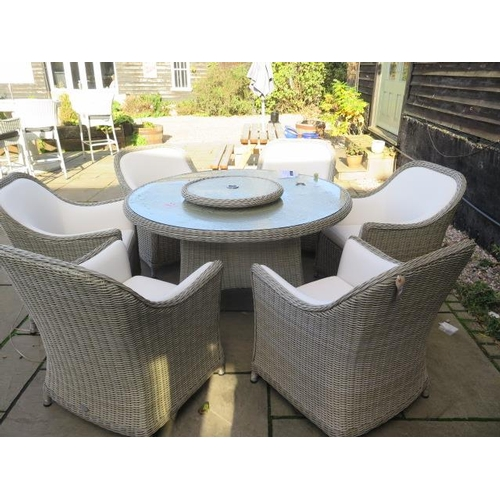 30 - A Bramblecrest Monte Carlo dining set, 140cm round table, lazy Susan, six armchairs and 3metre sand ...