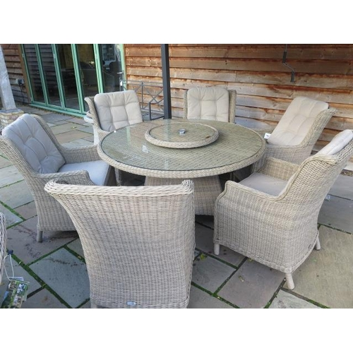 33 - A Bramblecrest Oakridge 140cm round dining set, with lazy Susan, and six high back dining armchairs...