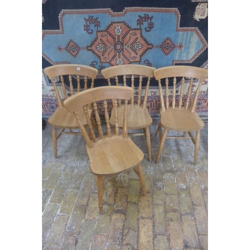 37 - A set of four beech kitchen chairs...