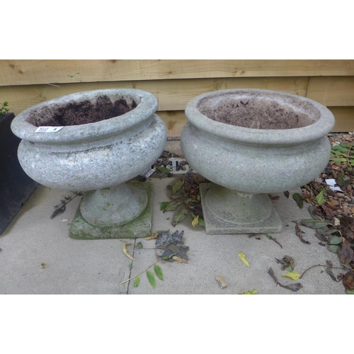 4 - A near pair of stone effect urns, 36cm tall...