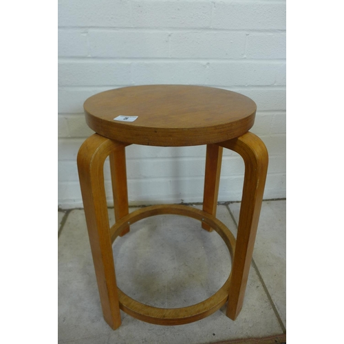 5 - A bent wood laminated stool in the style of Alvar Aalto, 48cm tall, seat 32cm diameter...