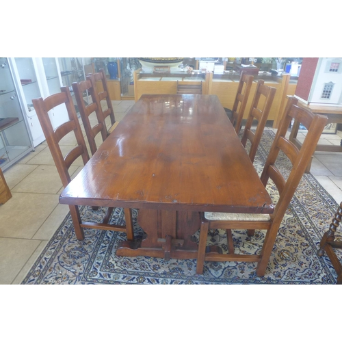 50 - A good quality cover oak refectory table with six ladder back rush seated chairs, 76cm tall x 221cm ...