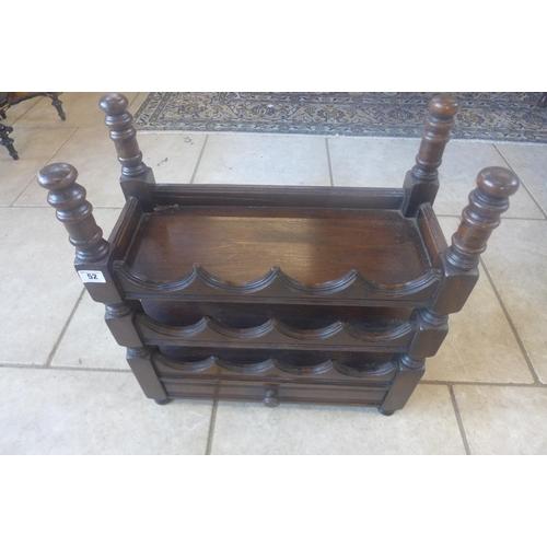 52 - An oak twelve bottle wine rack with a drawer, 57cm tall x 52cm x 24cm...