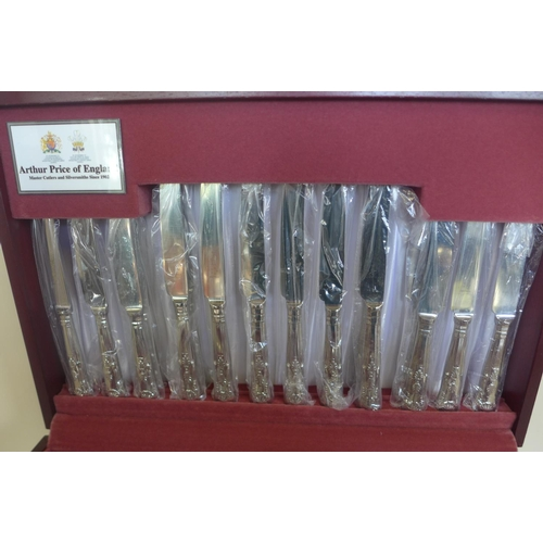 7 - An Arthur Price stainless steel eight person setting canteen of cutlery with four additional fish kn...