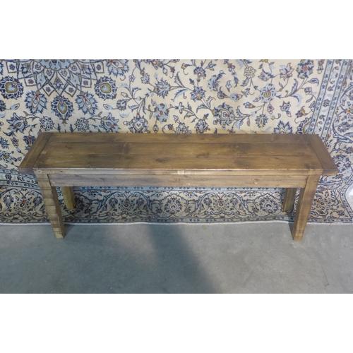 62 - A rustic pine bench 48cm tall x 143cm x 32cm...