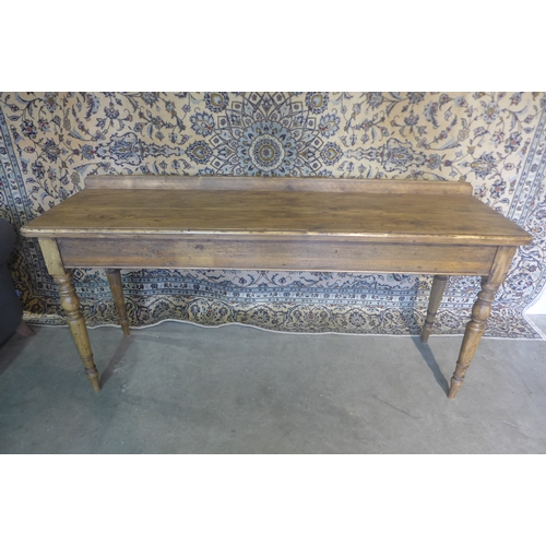 56 - A rustic pine serving table on turned legs, 89cm tall...