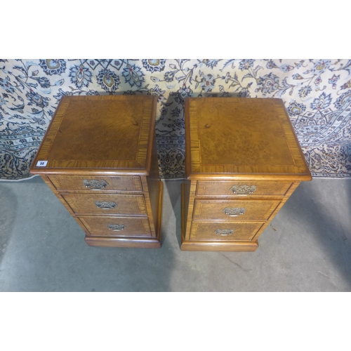 58 - A pair of burr oak three drawer bedside chests made by a local craftsman to a high standard  incorpo...