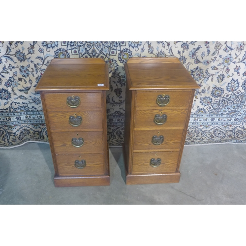 57 - A pair of oak bedside four drawer chests, restored by a local craftsman 75cm.  H x 39cm x 38cm...