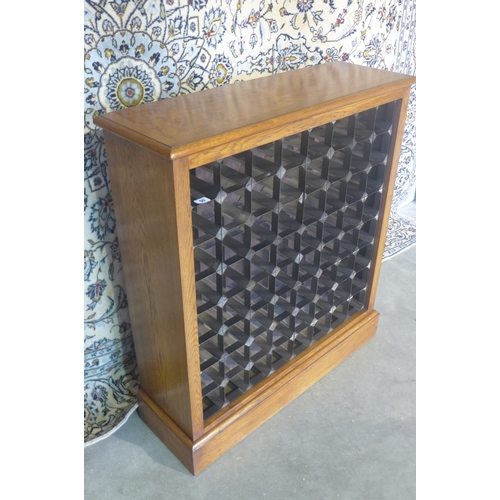59 - An oak sixty-four bottle wine rack, made by a local craftsman to a high standard - 97cm H x 88cm x 2...