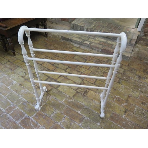 13 - A white painted Victorian towel rail...
