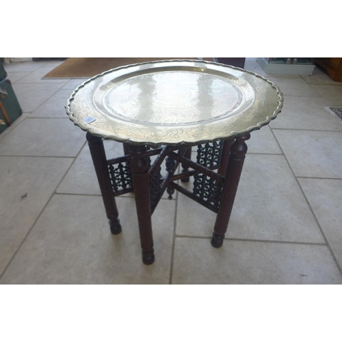 15 - A Benairs table, with a brass dish top, 56cm tall, 60cm diameter...