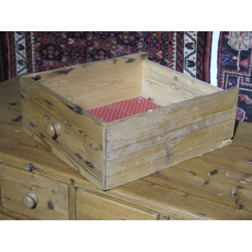 27 - A stripped pine thirteen drawer merchants chest, made from old timbers, 84cm tall x 120cm x 48cm...