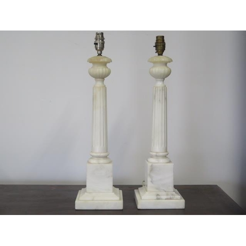 34 - A pair of white marble table lamps, 52cm tall, and a pair of shades, shades need fittings...