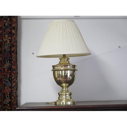 36 - A lacquered brass table lamp with shade, 64cm tall...