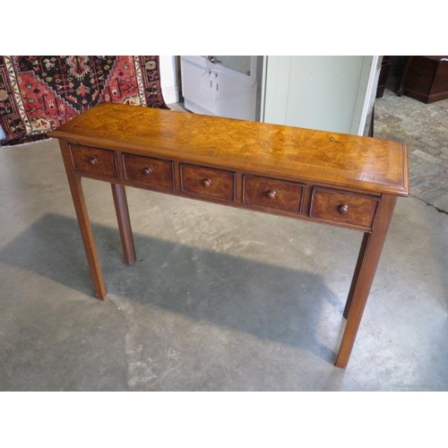 44 - A walnut hall table with five small drawers, 77cm H x 108cm x 30cm - made by a local craftsman to a ...