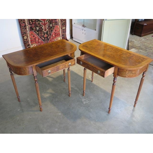 49 - A pair of walnut D shaped side tables with a single drawer on turned reeded legs, made by a local cr...