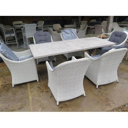 50 - A Bramblecrest Monterey rectangular table, 155cm x 90cm, with six chairs, ex-display...