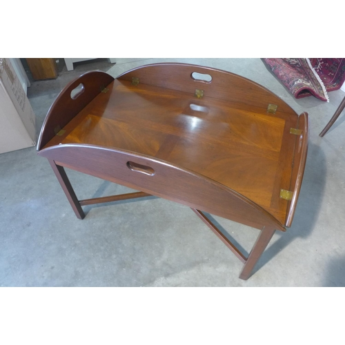 79 - A mahogany butlers tray on stand on the form of a coffee table, 63cm H x 93cm x 62cm closed...