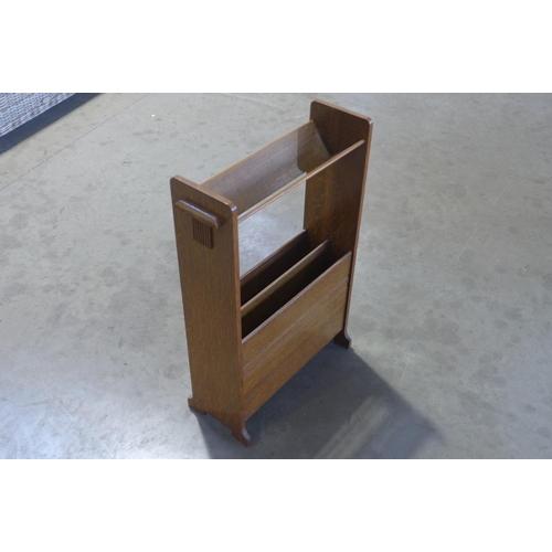 57 - An oak 1930's/Art Deco book trough and magazine rack, height 72cm, width 50cm, depth 20cm, clean con...