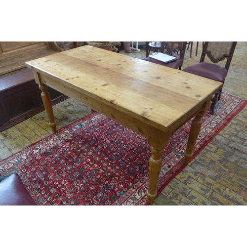 8 - A Victorian style stripped pine table with a long drawer on turned legs,  81cm tall x 153cm x 75cm -...