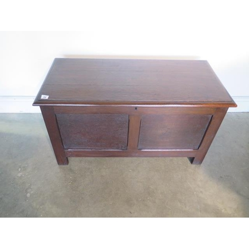 12 - An oak two panel early 20th century coffer/blanket box, 50cm tall x 93cm x  - in good polished condi...